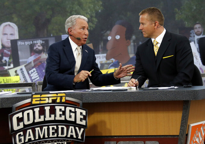 "FILE - In this Oct. 11, 2014, file photo, ESPN College GameDay hosts Lee Corso, left, and Kirk Herbstreit confer during the telecast from The Junction prior to Mississippi State playing Auburn in an NCAA college football game in Starkville, Miss. This week the Cornhuskers are front and center. Their game against No. 5 Ohio State on Saturday night was always going to be a big one. Add a visit from ESPN's ""College GameDay"" show in the morning, and it becomes huge. (AP Photo/Rogelio V. Solis, File)"