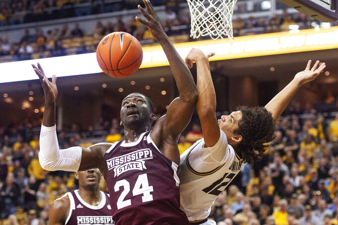 Mississippi State's Abdul Ado, left, and Missouri's Dru Smith, right, battle for a rebound during the second half of an NCAA college basketball game Saturday, Feb. 29, 2020, in Columbia, Mo. Mississippi State won 67-63. (AP Photo/L.G. Patterson)