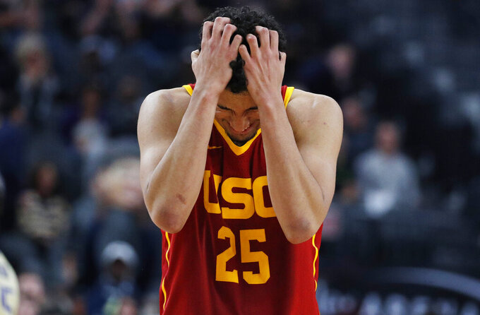 Southern California's Bennie Boatwright reacts as his team trails Washington in the closing seconds of the second half of an NCAA college basketball game in the quarterfinal round of the Pac-12 men's tournament Thursday, March 14, 2019, in Las Vegas. (AP Photo/John Locher)