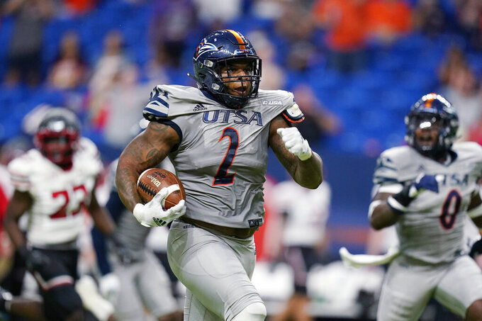 UTSA's Charles Willey (2) returns a fumble for a touchdown against Lamar during the first half of an NCAA college football game Saturday, Sept. 11, 2021, in San Antonio. (AP Photo/Eric Gay)