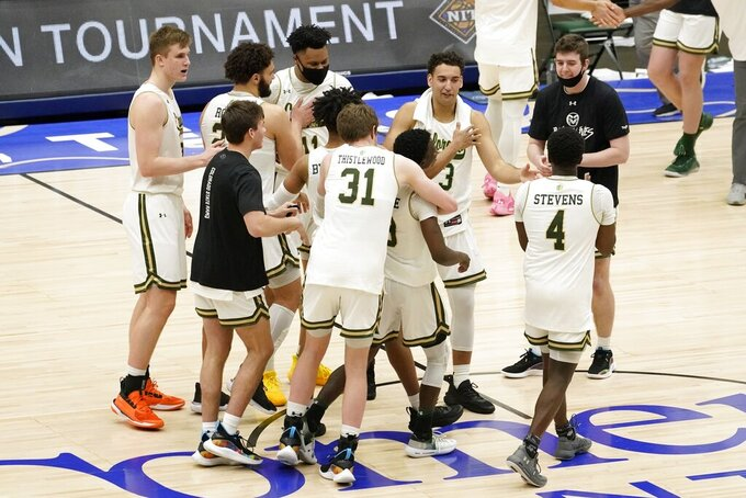 Colorado State's Adam Thistlewood (31), Isaiah Stevens (4) and others celebrate a win against North Carolina State in an NCAA college basketball game in the quarterfinals of the NIT, Thursday, March 25, 2021, in Frisco, Texas. (AP Photo/Tony Gutierrez)