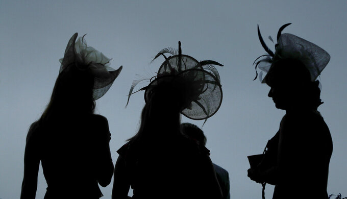 Women wear hats before the 145th running of the Kentucky Derby horse race at Churchill Downs Saturday, May 4, 2019, in Louisville, Ky. (AP Photo/Matt Slocum)