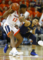 Virginia guard De'Andre Hunter (12) keeps the ball from Notre Dame guard Temple T.J. Gibbs, right, during the first half of an NCAA college basketball game in Charlottesville, Va., Saturday, Feb. 16, 2019. (AP Photo/Steve Helber)