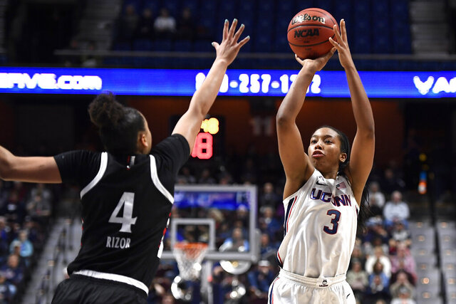 Connecticut's Megan Walker (3) shoots over Cincinnati's Angel Rizor (4) during the first half of an NCAA college basketball game in the American Athletic Conference tournament finals at Mohegan Sun Arena, Monday, March 9, 2020, in Uncasville, Conn. (AP Photo/Jessica Hill)