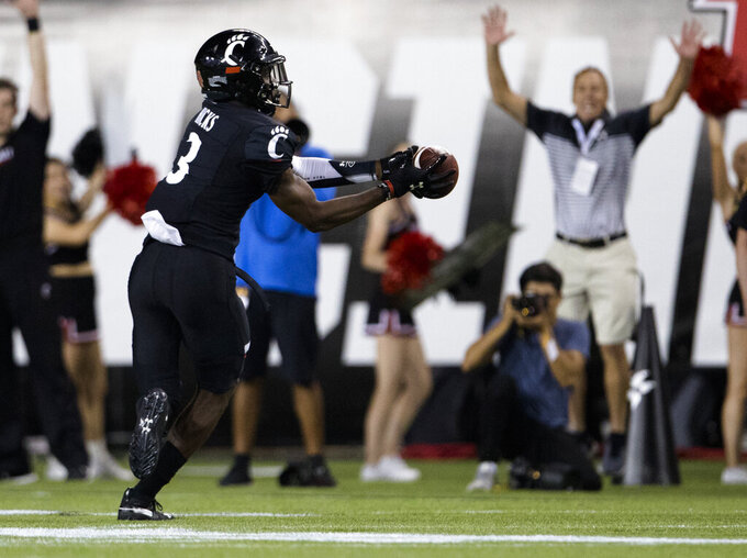 Cincinnati safety Ja'von Hicks (3) intercepts a UCLA pass during the second half of an NCAA college football game Thursday, Aug. 29, 2019, in Cincinnati. (Albert Cesare/The Cincinnati Enquirer via AP)