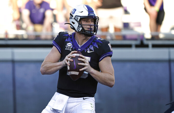 TCU quarterback Max Duggan (15) looks to throw against Texas Tech during the first half of an NCAA college football game Saturday, Nov. 7, 2020, in Fort Worth, Texas. (AP Photo/Ron Jenkins)