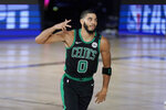 Boston Celtics' Jayson Tatum (0) gestures after scoring against the Miami Heat during the first half of an NBA conference final playoff basketball game, Tuesday, Sept. 15, 2020, in Lake Buena Vista, Fla. (AP Photo/Mark J. Terrill)