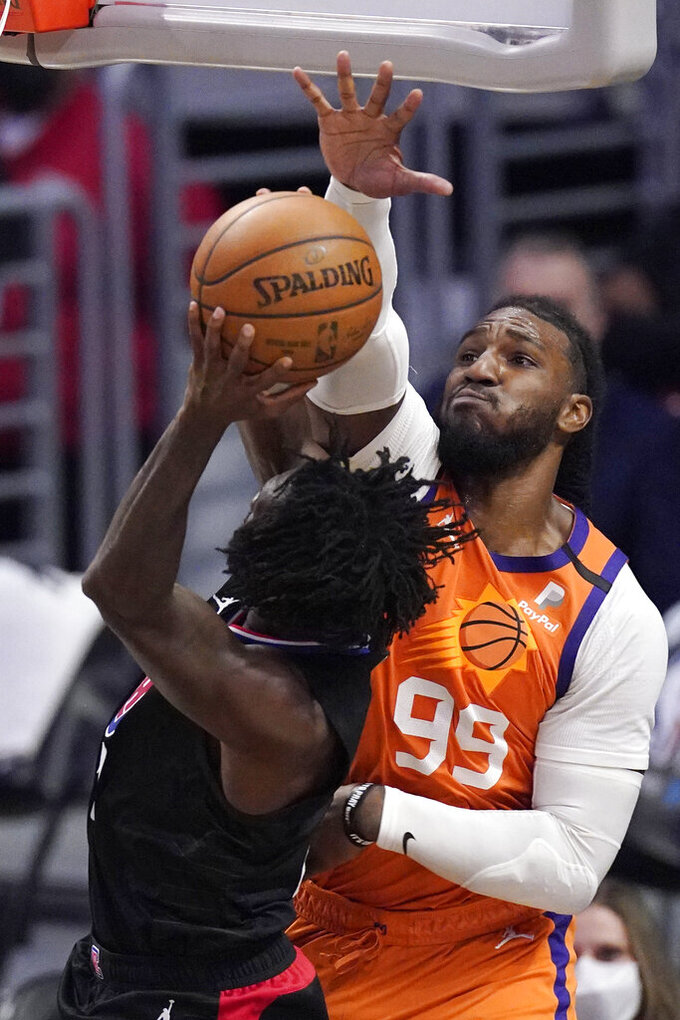 Los Angeles Clippers guard Patrick Beverley, left, shoots as Phoenix Suns forward Jae Crowder defends during the first half in Game 6 of the NBA basketball Western Conference Finals Wednesday, June 30, 2021, in Los Angeles. (AP Photo/Mark J. Terrill)