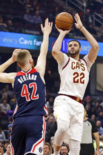 Cleveland Cavaliers' Larry Nance Jr. (22) shoots over Washington Wizards' Davis Bertans (42) in the first half of an NBA basketball game, Thursday, Jan. 23, 2020, in Cleveland. (AP Photo/Tony Dejak)