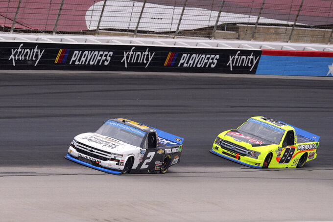 NASCAR Texas Trucks Series drivers Sheldon Creed (2) and Matt Crafton (88) make their way down the front stretch during an auto race at Texas Motor Speedway in Fort Worth, Texas, Sunday, Oct. 25, 2020. (AP Photo/Richard W. Rodriguez)