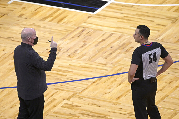 Orlando Magic head coach Steve Clifford, left, argues a call with official Ray Acosta during the second half of the team's NBA basketball game against the Atlanta Hawks, Wednesday, March 3, 2021, in Orlando, Fla. (AP Photo/Phelan M. Ebenhack)
