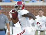 Alabama wide receiver Jerry Jeudy (4) looks for Mississippi defenders on his way to a 79-yard touchdown reception during the first half of their NCAA college football game on Saturday, Sept. 15, 2018, in Oxford, Miss. Alabama won 62-7. (AP Photo/Rogelio V. Solis)