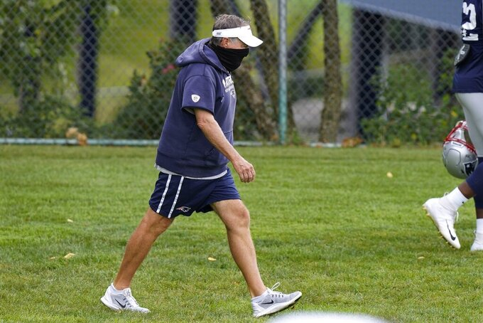 New England Patriots head coach Bill Belichick enters the field for an NFL football training camp practice, Monday, Aug. 17, 2020, in Foxborough, Mass. (AP Photo/Steven Senne, Pool)