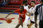 Houston guard DeJon Jarreau (3) drives to the basket while SMU forward Ethan Chargois (25) defends during the first half of an NCAA college basketball game in Dallas, Sunday, Jan. 3, 2021. (AP Photo/Roger Steinman)