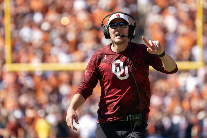 Oklahoma head coach Lincoln Riley yells at a referee during the second half of an NCAA college football game against Texas at the Cotton Bowl, Saturday, Oct. 9, 2021, in Dallas. (AP Photo/Jeffrey McWhorter)