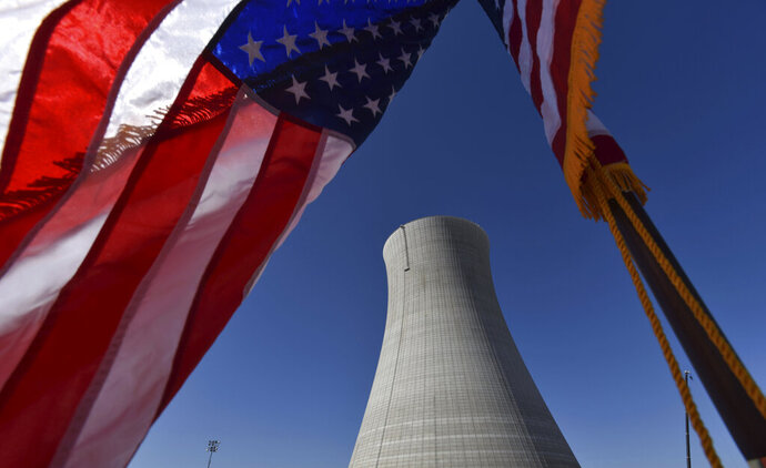 FILE - In this March 22, 2019 file photo, the construction site of Vogtle Units 4 at the Alvin W. Vogtle Electric Generating Plant is seen, Friday, March 22, 2019 in Waynesboro, Ga. It's not just cutbacks in nuclear plant inspections. Nuclear plant regulators are planning fewer mock commando raids to test plant defenses against terrorist attacks and are considering minimizing some safety warning, part of the rollbacks sought by the industry and gaining traction under President Donald Trump.   (Hyosub Shin/Atlanta Journal-Constitution via AP)