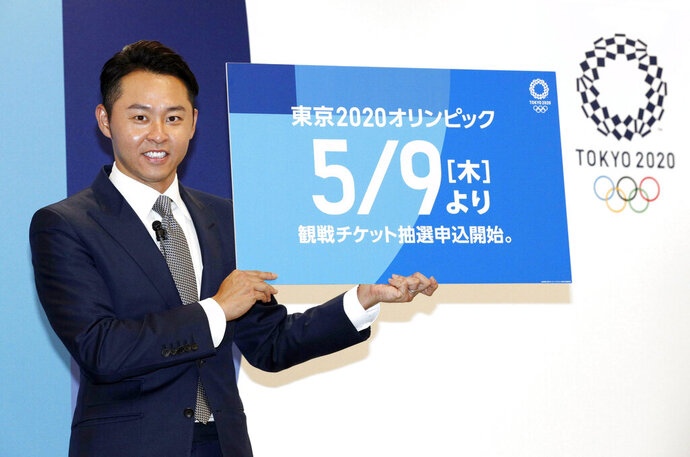 Kosuke Kitajima, a four-time Olympic swimming gold medalist attends a press conference in Tokyo Thursday, April 18, 2019. Kitajima helped Tokyo Olympic organizers launch their ticket website on Thursday, which is where only Japan residents can buy tickets when they go on sale in Japan on May 9. But the useful site can also be accessed by people outside Japan, where basic prices are listed along with the full competition schedule. (Yuta Omori/Kyodo News via AP)