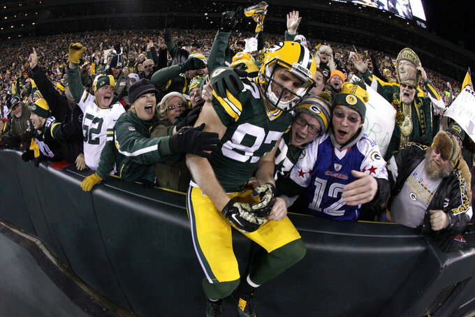 FILE - In this Nov. 9, 2014, file photo, Green Bay Packers wide receiver Jordy Nelson (87) celebrates a touchdown with fans during the first half of an NFL football game against the Chicago Bears, in Green Bay, Wis. Nelson signed a one-day contract with the Packers on Tuesday, Aug. 6, 2019, and announced his retirement after 11 seasons, 10 of which he spent in Green Bay. (AP Photo/Morry Gash, File)