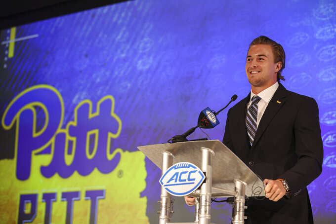 Pittsburgh quarterback Kenny Pickett answers a question during an NCAA college football news conference at the Atlantic Coast Conference media days in Charlotte, N.C., Wednesday, July 21, 2021. (AP Photo/Nell Redmond)