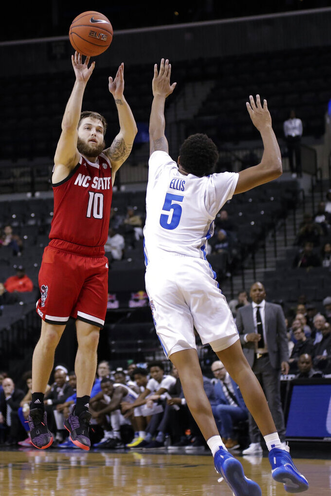 North Carolina State's Braxton Beverly (10) shoots over Memphis' Boogie Ellis (5) during the second half of an NCAA college basketball game in the Barclays Classic, Thursday, Nov. 28, 2019, in New York. Memphis won 83-78. (AP Photo/Frank Franklin II)