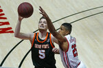 Utah guard Alfonso Plummer (25) and Idaho State guard Austin Smellie (5) battle for a rebound during the first half of an NCAA college basketball game Tuesday, Dec. 8, 2020, in Salt Lake City. (AP Photo/Rick Bowmer)