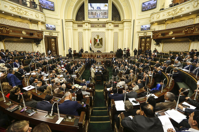 FILE - In this Feb 13, 2019 file photo, Egypt's Parliament meets in Cairo Egypt. The Egyptian Parliament is likely to vote Monday, July 20, 2020, to authorize the country's president to deploy troops to war-torn Libya if Turkey-backed forces allied with the U.N.-supported government in Tripoli move to retake the strategic coastal city of Sirte. The House of Representative, packed with the president's supporters, is highly likely to vote in favor of sending troops. Egypt has been backing the east-based Libyan forces in the conflict while Turkey backs the forces in Tripoli, in the west. (AP Photo, File)