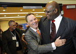 """FILE - In this Tuesday, June 10, 2014 file photo, the Rev. Ronnie Floyd, center, of Cross Church in northwest Arkansas, hugs the Rev. Dwight McKissic, right, of Cornerstone Baptist Church in Arlington, Texas, after Floyd was elected the new president of the Southern Baptist Convention during its annual meeting in Baltimore. Ahead of the June 2021 meeting, Asian American and Hispanic participation increased, prompting Floyd to hail America's diversity as """"an amazing opportunity"""" for future growth. (AP Photo/Steve Ruark)"""