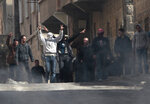 FILE - In this March 23, 2011 file photo, anti-Syrian government protesters flash Victory signs as they protest in the southern city of Daraa, Syria. The Syria Justice and Accountability Center, a Washington-based Syrian rights group said in a report, released Tuesday, May 21, 2019, that thousands of documents collected from abandoned Syrian government offices reveal the reach of President Bashar Assad's security agencies, offering a rare glimpse into the inner workings of his secretive apparatus. The documents include handwritten notes from top commanders to