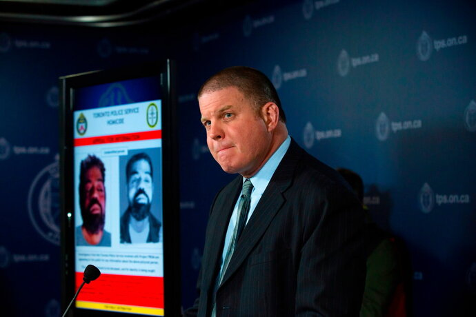 FILE - In this April 11, 2018 file photo, Toronto police Detective Sgt. Hank Idsinga speaks to the media regarding an unidentified male believed to be connected to the Bruce McArthur case, during a press conference at the Toronto Police Headquarters in Toronto. Idsinga said Monday, April 16, 2018, that McArthur, a 66-year-old landscaper, is now facing an eighth murder charge. (Cole Burston/The Canadian Press via AP File)