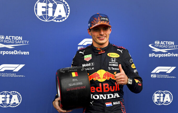 First place for pole position Red Bull driver Max Verstappen of the Netherlands holds the prize after qualification ahead of the Formula One Grand Prix at the Spa-Francorchamps racetrack in Spa, Belgium, Saturday, Aug. 28, 2021. The Belgian Formula One Grand Prix will take place on Sunday. (John Thys, Pool Photo via AP)