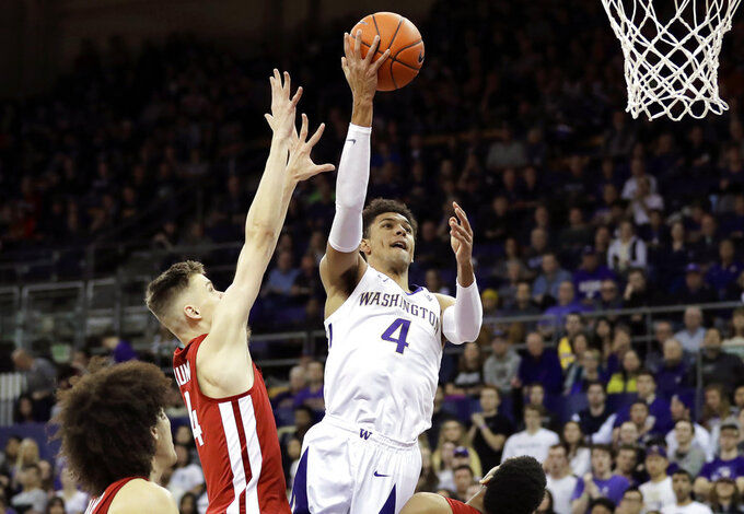 Washington guard Matisse Thybulle, right, shoots over Washington State forward Aljaz Kunc, left, during the first half of an NCAA college basketball game, Saturday, Jan. 5, 2019, in Seattle. (AP Photo/Ted S. Warren)