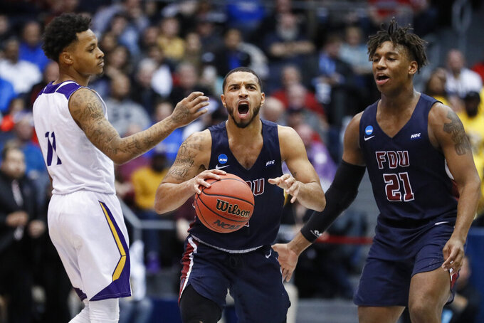 Fairleigh Dickinson's Darnell Edge, center, reacts alongside Elyjah Williams (21) and Prairie View A&M's Dennis Jones (11) after winning a First Four game of the NCAA college basketball tournament, Tuesday, March 19, 2019, in Dayton, Ohio. (AP Photo/John Minchillo)
