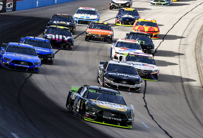Kevin Harvick (4) leads the field into turn one during a NASCAR auto race at Texas Motor Speedway, Sunday, Nov. 3, 2019, in Fort Worth, Texas. (AP Photo/Larry Papke)