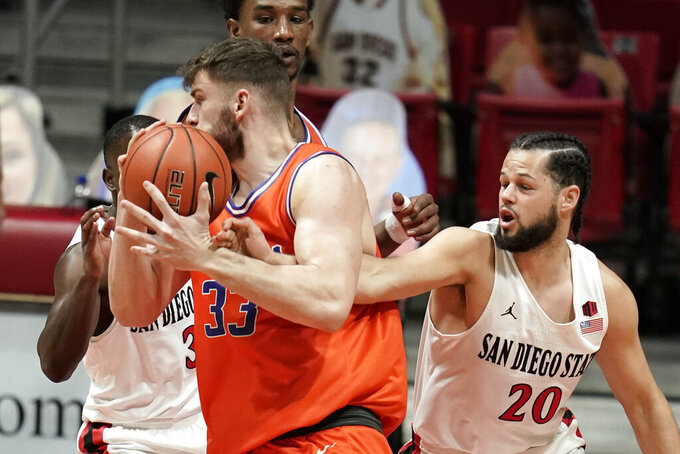 Boise State forward Mladen Armus (33) loses the ball to San Diego State guard Jordan Schakel (20) during the first half of an NCAA college basketball game Saturday, Feb 27, 2021, in San Diego. (AP Photo/Gregory Bull)