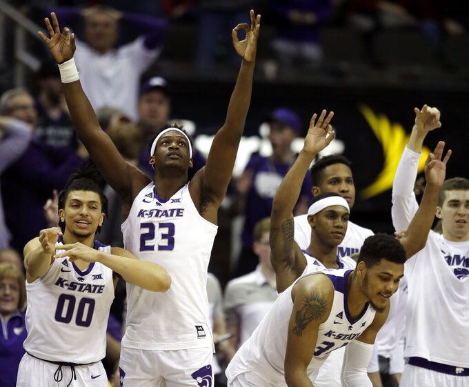 Kansas State guard Mike McGuirl (00) and forward Austin Trice (23) celebrates with teammates during the second half of an NCAA college basketball game against TCU in the quarterfinals of the Big 12 conference tournament in Kansas City, Mo., Thursday, March 14, 2019. (AP Photo/Orlin Wagner)