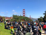 Dozens of people gather by the Golden Gate Bridge Welcome Center in San Francisco Saturday, June 6, 2020, to begin marching across the famous span in support of the Black Lives Matter movement. (AP Photo/Jeff Chiu)