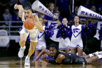 Kansas State's Mike McGuirl, left, steals the ball from Alabama State's D.J. Heath, right, during the second half of an NCAA college basketball game Wednesday, Dec. 11, 2019, in Manhattan, Kan. (AP Photo/Charlie Riedel)