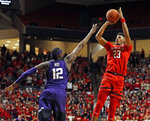 Texas Tech's Jarrett Culver (23) jumps back to shoot the ball over TCU's Kouat Noi (12) during the second half of an NCAA college basketball game Monday, Jan. 28, 2019, in Lubbock, Texas. (AP Photo/Brad Tollefson)