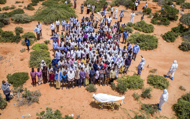 FILE - In this April 30, 2020, file photo, mourners gather to bury an elderly man believed to have died of the coronavirus but whose family asked not to be named because of the social stigma, in Mogadishu, Somalia. A dangerous stigma has sprung up around the coronavirus in Africa — fueled, in part, by severe quarantine rules in some countries as well as insufficient information about the virus. (AP Photo/File)