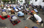 Muslim men pray spaced apart amid concerns of coronavirus outbreak during a Friday prayer at a mosque in Jakarta, Indonesia, Friday, June 5, 2020. Muslims in Indonesia's capital held their first communal Friday prayers as mosques closed by the coronavirus outbreak for nine weeks reopened at half capacity. (AP Photo/Dita Alangkara)