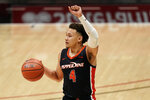 Pepperdine guard Colbey Ross brings the ball up during the second half of the team's NCAA college basketball game against UCLA, Friday, Nov. 27, 2020, in San Diego. (AP Photo/Gregory Bull)