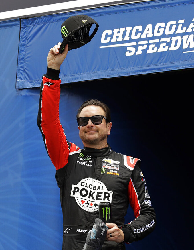 Kurt Busch waves to the crowd during driver introductions before a NASCAR Cup Series auto race at Chicagoland Speedway in Joliet, Ill., Sunday, June 30, 2019. (AP Photo/Nam Y. Huh)