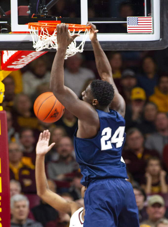 Penn State forward Mike Watkins (24) dunks the ball during the first half of an NCAA basketball game against the Minnesota, Saturday, Jan. 19, 2019, in Minneapolis. (AP Photo/Paul Battaglia)