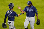 Tampa Bay Rays relief pitcher Diego Castillo, right, and catcher Michael Perez (7) celebrate their victory over the New York Yankees in a baseball game, Monday, Aug. 31, 2020, at Yankee Stadium in New York. (AP Photo/Kathy Willens)