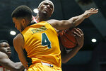 Mississippi guard Blake Hinson, right, and Southeastern Louisiana forward Maxwell Starwood (4) collide while going for a rebound during the second half of an NCAA college basketball game, Saturday, Dec. 21, 2019, in Jackson, Miss. (AP Photo/Rogelio V. Solis)