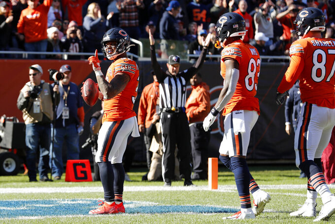 Chicago Bears running back David Montgomery, left, celebrates after scoring on a 4-yard touchdown run during the second half of an NFL football game against the Los Angeles Chargers, Sunday, Oct. 27, 2019, in Chicago. (AP Photo/Charles Rex Arbogast)