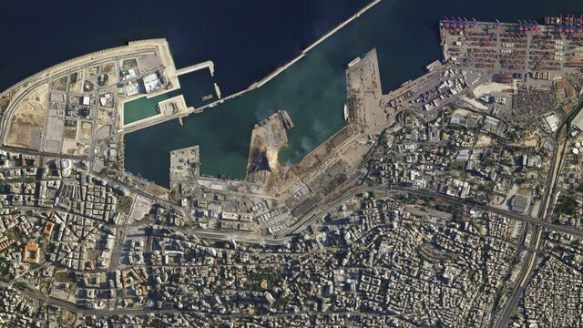This satellite image taken on Wednesday Aug. 5, 2020 shows the port of Beirut and the surrounding area in Lebanon following a massive explosion on Tuesday. Residents of Beirut confronted a scene of utter devastation a day after a massive explosion at the port rippled across the Lebanese capital, killing at least 100 people, wounding thousands and leaving entire city blocks blanketed with glass and rubble. (Planet Labs Inc. via AP)