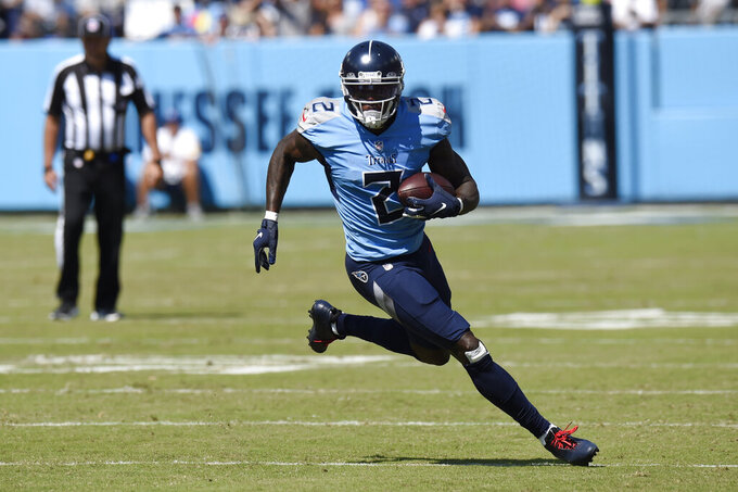 Tennessee Titans wide receiver Julio Jones carries the ball against the Indianapolis Colts in the first half of an NFL football game Sunday, Sept. 26, 2021, in Nashville, Tenn. (AP Photo/Mark Zaleski)