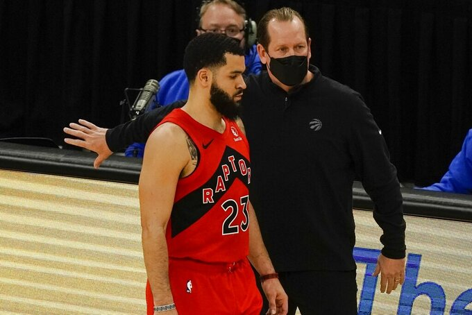 Toronto Raptors head coach Nick Nurse talks to Fred VanVleet during the first half of an NBA basketball game against the Milwaukee Bucks Thursday, Feb. 18, 2021, in Milwaukee. (AP Photo/Morry Gash)