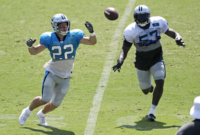 Carolina Panthers' Christian McCaffrey (22) misses a catch as Andre Smith (57) defends during practice at the NFL football team's training camp in Spartanburg, S.C., Saturday, July 27, 2019. (AP Photo/Chuck Burton)